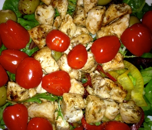 Everything But The Kitchen Sink Salad: Chicken, Green Olives, Red Capsicum, Yellow Capsicum and Tomatoes on a bed of Mixed Greens