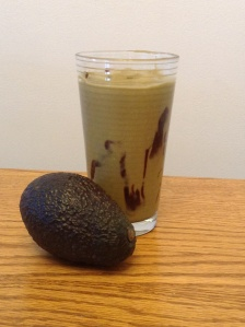 Jus Alpukat: Avocado, Yogurt, Vanilla Almond Milk, Honey, Coconut Palm Sugar, Carob Powder
